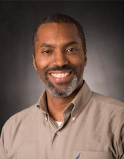 A headshot of an African American man