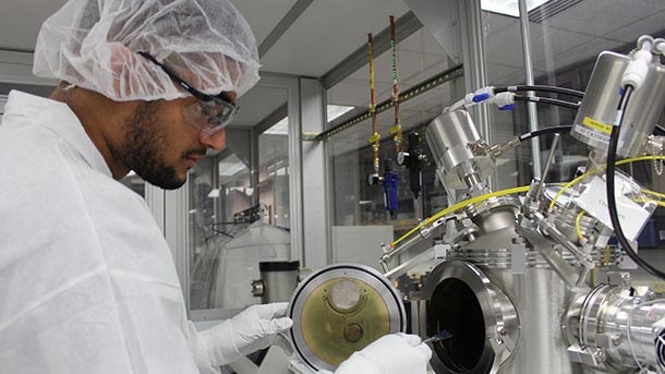 student working in nanotechnology clean room