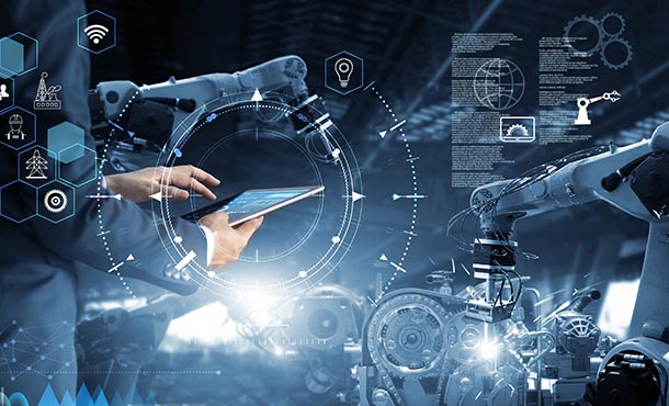Text and graphics overlay a picture of a person holding an electronic tablet and standing beside a robotic arm