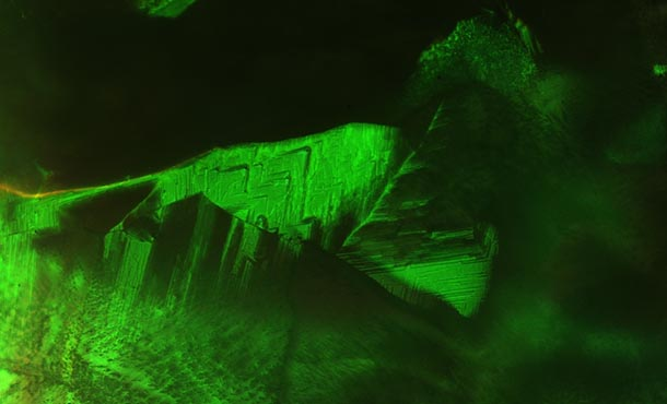 green image of a blue liquid crystal