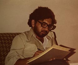 Muhammad Nawaz writes on a notepad when he was a student at Penn State.