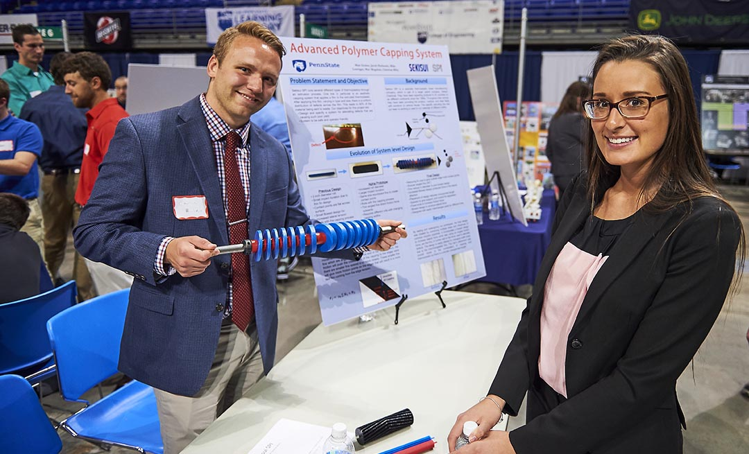 two engineering students display there senior project at the spring 2016 design showcase
