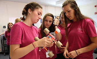 first-year women engineering students work on a group activity during orientation