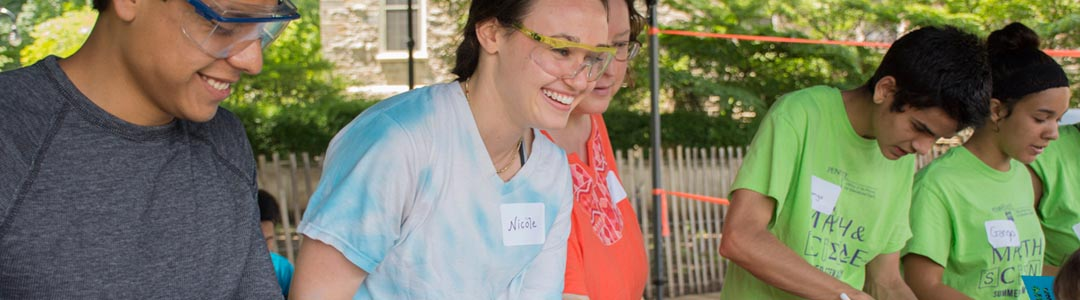 engineering ambassadors demonstrate how science and engineering can be fun at a STEM education event