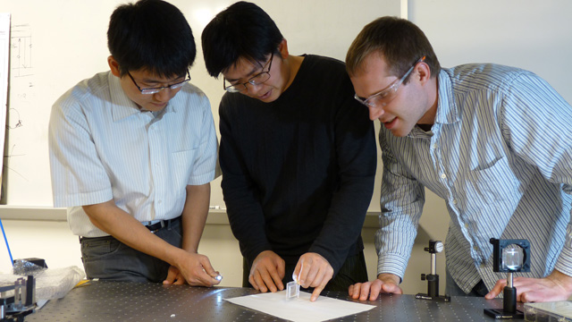 Zhiwen Liu and two of his research students working in the lab